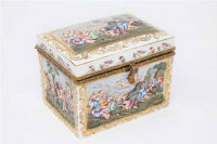 A continental porcelain lidded table casket, painted with scenes of classical figures revelling, height 15cm.