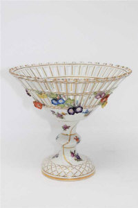 A continental porcelain pedestal fruit bowl, with blue crossed swords mark to base, height 19cm.