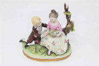 A Capodimonte porcelain figure of a girl and boy seated on a tree branch, height 13cm.