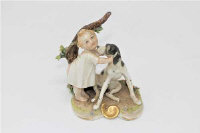 A Capodimonte porcelain figure of a baby and dog, height 9cm.