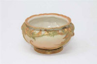 A Royal Worcester gilded blush ivory bowl, height 10 cm.