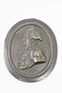 A 19th century bronze plaque depicting an admiral, height 11cm.