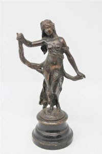 A Victorian patinated metal figure of a maiden on turned wooden plinth, height 30cm.