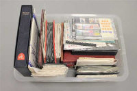 A large collection of stamps, First Day covers, early 20th century stamp albums. (q)