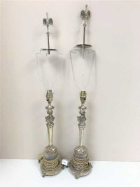 A pair of Egyptian Revival silver plated and cut glass table lamps.