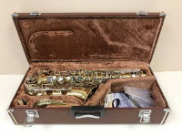 A cased Yamaha saxophone stamped YAS-25 046939.