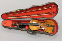 A late nineteenth / early twentieth century violin, back length 13.75 inches, with two bows of a later period.