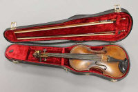 A nineteenth century violin, bearing paper label within 'Carlo Giuseppe Testore', back length 14 inches, together with two later bows.