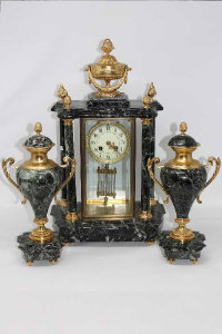 A French marble and gilt metal mounted three-piece striking clock garniture, the clock 50cm high.