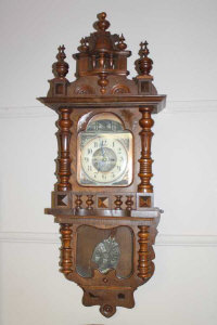 A 19th century carved oak 8 day wall clock with enamel dial, height 112cm.