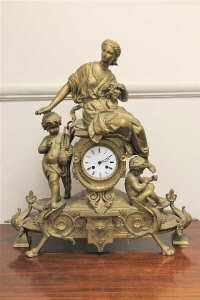 A gilt metal 8 day figural mantel clock with enamel dial, height 55cm.