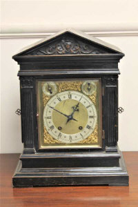 A Victorian oak 8 day chiming bracket clock, height 41cm.