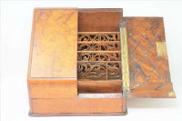 A Victorian walnut sloped-front correspondence box.