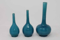 A graduated trio of 19th century Chinese bottle vases on turquoise ground, height 23 cm.