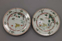 A pair of Chinese 18th century cabinet plates, decorated with flora and fauna, diameter 22 cm. (2)