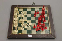 A 19th century stained ivory chess set, (part), together with a wooden chess board of the same period.