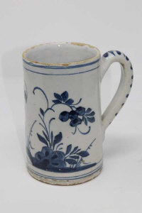 An 18th century blue and white delft mug, height 18 cm.