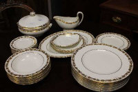 Thirty nine pieces of Wedgwood Whitehall W4001 gilded dinner ware. (39)