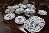 Fifty five pieces of Copeland Spode New Stone pattern blue and white dinner ware. (55)