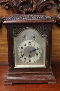 An early 20th century German bracket clock with pendulum and key.