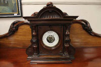A Victorian aneroid barometer in carved mahogany case.