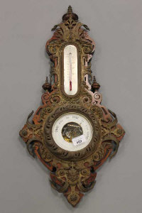 A Victorian holosteric barometer ornately mounted in embossed brass.