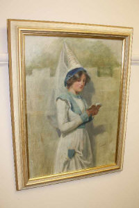 Manner of Ralph Hedley (1848-1913), a girl in traditional dress holding a prayer book, oil on canvas,  38cm by 54cm.