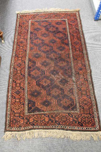 A Balouch rug, late 19th/early 20th century, 175cm by 95cm.