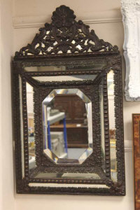 A 19th century repousse framed mirror.