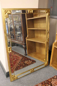 A contemporary gilt bevelled overmantel mirror, width 118cm.