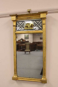 An early 19th century giltwood pier glass, height 59cm.