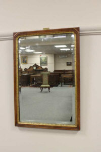 A 19th century walnut and parcel gilt mirror, height 49cm.
