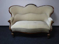 A 19th century walnut framed shaped back two seater settee, width 152cm.