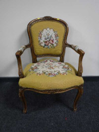 A continental walnut salon chair upholstered in floral fabric, width 58cm.