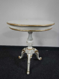 A 19th century style cream and gilded circular pedestal table.