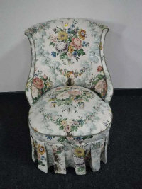 Two 19th century style floral covered salon chairs with shaped backs. (2)
