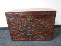 A Chinese lacquered storage chest, the front panel decorated with vines and birds, width 80cm.