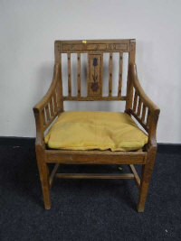 A 19th century oak armchair with floral carved back detail, width 58cm.