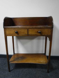 A 19th century mahogany washstand fitted with two drawers, width 67cm.