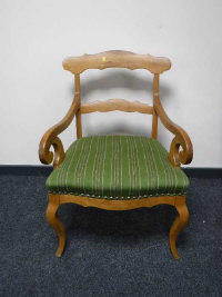 A 19th century walnut armchair upholstered in green striped fabric width 63cm.