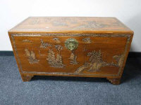 A mid 20th century carved Chinese camphor wood chest, width 104cm.
