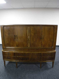A mid 20th century walnut bowfront sideboard, width 171cm.