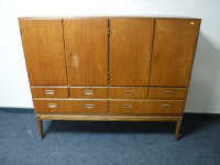 A mid 20th century teak sideboard, fitted with six drawers, width 154cm.