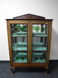 A 19th century Art Nouveau style mahogany display cabinet with leaded glazed doors, width 91cm.