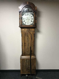 A 19th century longcase clock with painted dial by Clark of Morpeth, with pendulum and two weights, height 222cm.