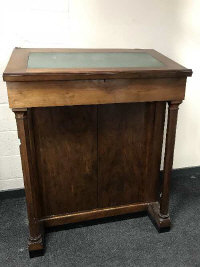 A 19th century mahogany clerk's desk fitted with cupboards beneath, width 103cm.