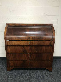 A 19th century mahogany cylinder bureau, fitted four drawers, width 110cm.