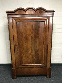 A 19th century mahogany single door cabinet, with arch top pediment, width 103cm.