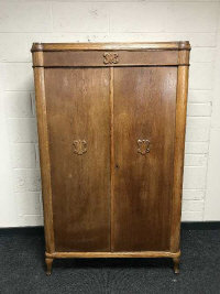 An early 20th century oak double door cabinet fitted with shelves, width 102cm.