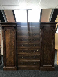 A mid-Victorian sentry door inverted breakfront compactum wardrobe, with central bank of seven drawers, width 206cm.